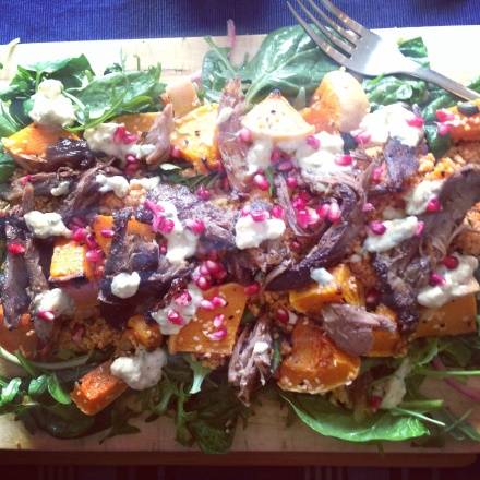 Leftover roast lamb with burnt aubergine and pomegranate molasses, pomegranate seeds, squash, cous cous and salad.